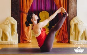 Bonnie demonstrating Ubhaya Padangushthasana (Both Big Toe pose)